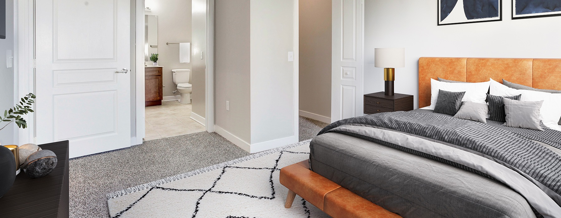 bedroom with large areas for a full bed, furniture and that includes easy access to bathroom